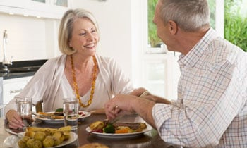 older-couple-enjoying-meal-350