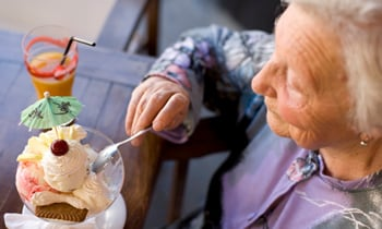 Old woman eating ice cream