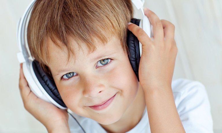 Boy with headphones smiling