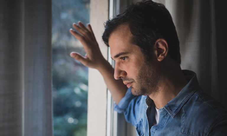 man-alone-looking-out-window-768