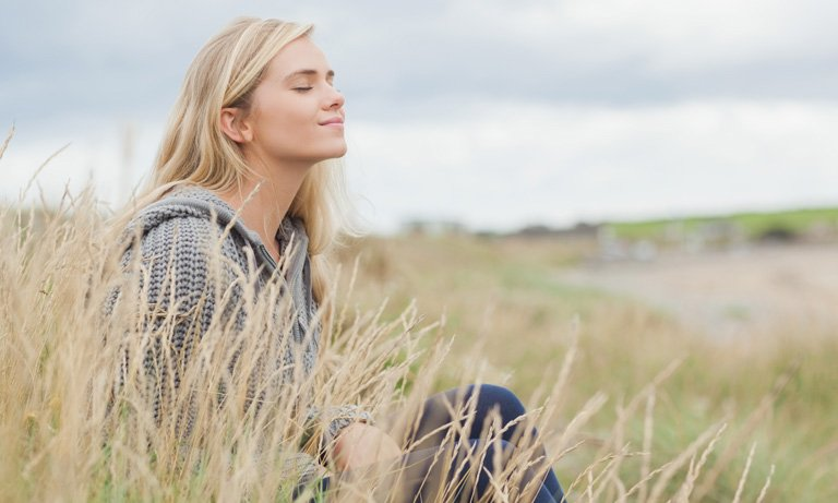 Young woman sitting in field