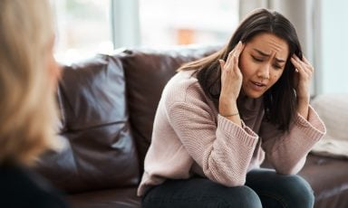 Distraught woman on therapy couch