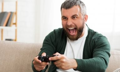 Middle-aged man playing video games