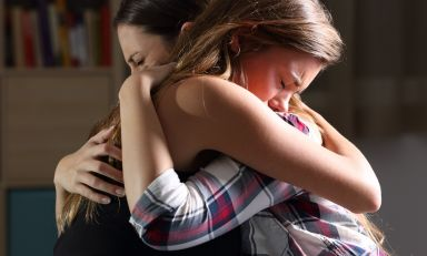 Women sharing grief, embracing